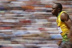 Bolt winning his first round at London 2012. Phil Noble - Reuters
