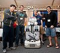 Student representatives at the PR2 Beta Workshop with our very own PR2, Graspy!