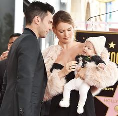 This is the cutest family ever. The way Adam and Behati look at Dusty Rose is so amazingly amazing.