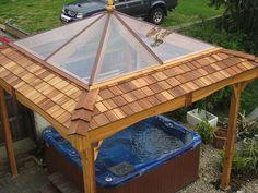 Large clear roof on cedar hot tub gazebo