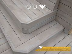 Millboard enhanced grain composite decking in golden oak with led