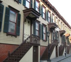 Sylvan Terrace (above), up a flight of stairs from St. Nicholas Avenue, is a two-sided stretch of 20 wooden row houses flanking a once-private lane. The three-story houses were built in 1882 and restored in the 1980s.