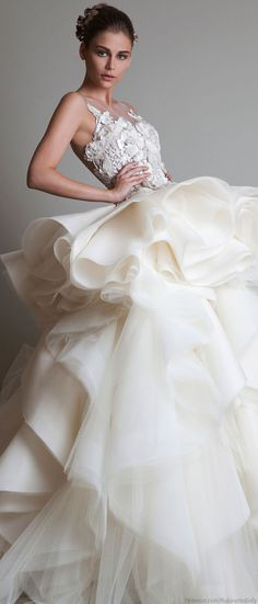 Very full layered, ruffled skirt on gorgeous high fashion bridal gown. This is by famous bridal gown designer Krikor Jabotian Couture, 2014. In my humble opinion, he is the absolute BEST wedding dress designer!