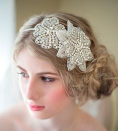 A beautiful crystal rhinestone headband for the bride who wants to be unique. The 1/8 metal headband is wrapped in silk ribbon in three choices