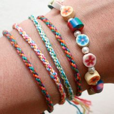 A tutorial for woven friendship bracelets, using a circular cardboard loom to make an easy rope-like bracelet, simple enough for kids too!