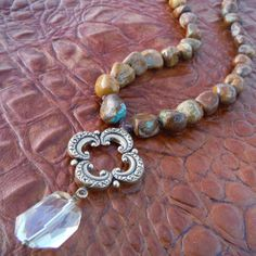 Brown turquoise hand knotted with antiqued brass pendant and crystal....Rockin Robbin Ranch