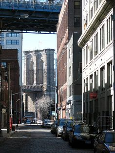 Looking westward from Jay Street along Plymouth Street, through Dumbo, under the Manhattan Bridge, at a pier of the Brooklyn Bridge