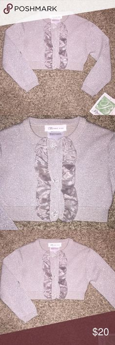 NWT! Gorgeous Silver Sparkle Bolero Ruffle Amazing NWT! Gorgeous Silver Sparkle Bolero with Ruffles down front. 3 Crystal Buttons down the front. Absolutely Stunning! Perfect for your he upcoming Holiday's by Bonnie Jean Bonnie Jean Shirts & Tops Sweaters