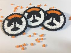 Show your support for overwatch with these cute buttons made out of mini perler beads! Order a set to share with friends or use as party favors! Please specify if you would like the full melt look or the open beaded look.