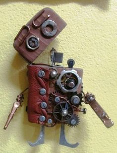 """Love these little """"robots"""" made of wood and metal scrap."""