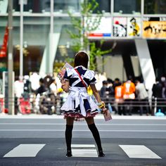 A Japanese maid cosplayer getting ready to sell, sell, sell in Akihabara.
