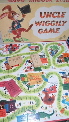 1961 Uncle Wiggily Board Game.  I remember playing this at Grandma L.'s house.  I have the game now at my house and it still has all the cards and two of the original player's discs.  Owen is starting to pretend that he is reading the cards - too cute!