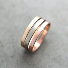 Minimalist Mixed Metals Wedding Band: This tri-colored stacked band is perfect for the minimalist bride with its simple design and clean lines. Plus, by incorporating rose gold, silver and gold into one ring, you'll never have to worry about mixing your jewelry metals again!