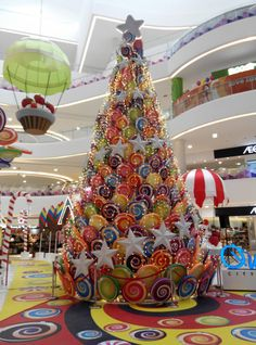 CHRISTMAS TREE~Candy tree in Kuala Lumpur, Malasya. Lollipop idea for ceiling decor. Visions of sugarplums danced in their heads. Unique Christmas Trees, Christmas Tree Themes, Christmas Gingerbread, Christmas Makes, Noel Christmas, Holiday Tree, Xmas Decorations, Xmas Tree, All Things Christmas