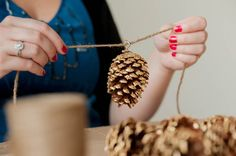 DIY gold leaf pine cone garland from The Sweetest Occasion   Photo by Alice G Patterson