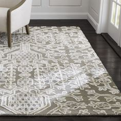Riffing on the traditional pomegranate motif used in Persian rugs, designer Barbara Costas reinterprets this symbol of abundance in a lush, dimensional rug. Scaled up and relaxed, the pattern takes shape in raised white rayon yarn on a tufted, loop-constructed grey wool ground.Shop all patterned rugs