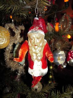 Blown glass Santa Christmas ornament with chenille arms and legs