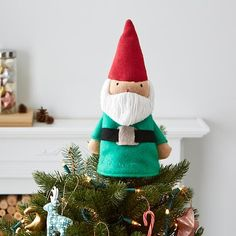Our High Point Tree Topper is sure to be the pinnacle of your holiday season. These very merry characters are made from soft cotton and wool yarn and include a pocket that will fit on top of any tree.