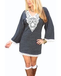 Figure-slimming tunic dress flows perfectly for a retro-chic polished look. Kimono sleeves, a crochet accent at neckline and lace trim make for the perfect go-to dress. Wear it as a mini dress or with leggings, perfect to pair with boots.