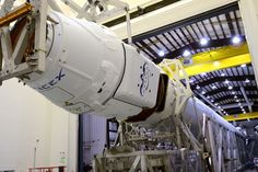 Dragon capsule mated to Falcon Rocket at SpaceX.