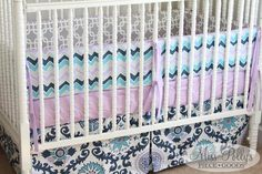 Bedding in 'Drew Berries' fabrics with reversible bumper pads. Custom made by MissPollysPieceGoods  #purple #reversible #bumperpads #cribbedding #nursery #chevron #ikat #gray https://www.etsy.com/listing/184063027/modern-crib-bedding-design-your-own-baby