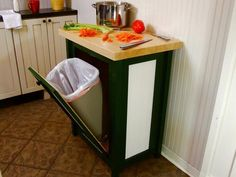 Buy cabinet about that size with door; take hinges on left side of door, move towards bottom; buy stopper, install catchers for trashcan??? I feel this is do-able !