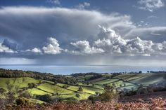 Ralph Rayner's encapsulation of the three facets meeting - the green rolling land, the ever changing sea and the shifting sky. Desktop Images, Free Time, Vintage Photographs, Devon, I Am Awesome, Clouds, Sky, Mountains, Landscape