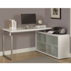 This office desk is ideal for home or business use. The L-shaped desk features a hollow core metal frame, white desktop and shelves with frosted glass.