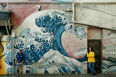 A street mural depicting 'The Great Wave' on a wall in Sydney, Australia.