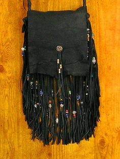 That purse with the fringe....when it gets ratchet ...add some beads and bleach/colors ...make it boho pimp style
