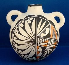 Native American Hand Coiled & Hand Painted Acoma Pueblo Indian Pottery Water Jug by Vivian Seymour. $59.99 plus 8.00 for Shipping. Just click on the above picture to be taken to the Ebay listing.
