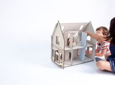 Lille Huset by growbookspress.wordpress.com: A series of flatpack dollhouses made of laser cut recycled paper board, easily assembled and meant to be played with and custom decorated or not! #Doll_House #Lille_Huset #growbookspress