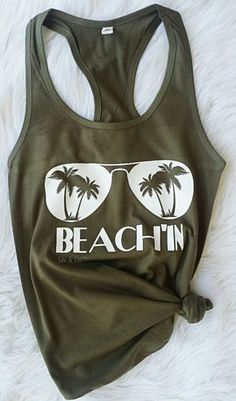 """SHIPPING in the USA The most awesome pair of shades with palm tree's in the lenses and """"BEACH'IN"""" underneath, printed on your choice of a cozy cotton tee shirt (for men or women) or cotton/poly lightweight racerback jersey tank top (for men or women). Beach Tanks, Beach T Shirts, Summer Shirts, Cute Shirts, Summer Tank Tops, Looks Hippie, Women's Dresses, Vinyl Shirts, Mode Outfits"""