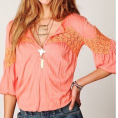 Free people blouse Pretty, soft & flowy! Pre-loved! Small petite. Banded arms & clean cut across the bottom with no stitching so shirt is flowy. 100% polyester. Color true to stock photos & 4th photo. Free People Tops Blouses