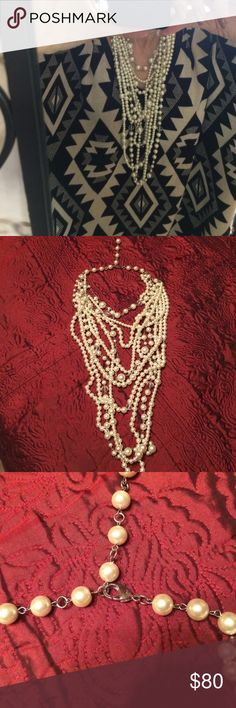 Heavy necklace of Twisted pearl layers galore. Heavy statement piece! Twisted layers of Pearls galore and crystals. Long and short layers ... gorgeous! Jewelry Necklaces