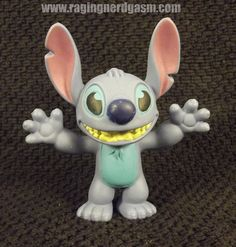 Disney's Stich Figurine. Check out our flickr at http://www.flickr.com/photos/ragingnerdgasm/sets/72157631063803430/