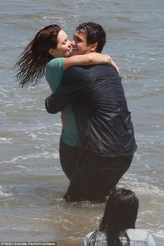 Fun in the sun: The couple had been filming scenes for drama Scorpion on the beach...