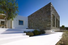 As House is situated on a slope on Paros Island. The scheme suggests an agglomeration of ''primitive'' volumes and a reinterpretation of the Cycladic Vernacular Architecture. The dry-stone wall is re- […] Vernacular Architecture, Contemporary Architecture, Paros, Concrete Bricks, Construction, Landscape Design, Greece, House Design, Mansions