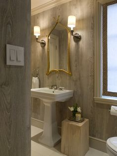 Benjamin Dhong - Chic bathroom design with faux bois wallpaper, white pedestal sink, ...