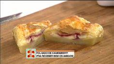 As trouxinhas de massa folhada levam recheio de queijo camembert e geleia caseira de framboesa. Experimente também fazer a receita com queijo emmental e geleia de morango.<br/><br/>Veja todos os vídeos do <a href=http://www.band.com.br/diadia/receitas.asp>Dia Dia</a>