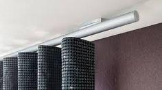 https://i.pinimg.com/236x/12/9e/d0/129ed063521e54675eaa3f53651dedb2--curtain-rails-curtain-ideas.jpg