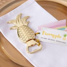 These gold pineapple bottle openers are the perfect favor for any destination or tropical themed wedding!