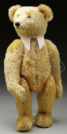 LARGE GOLD STEIFF BEAR WITH BUTTON.