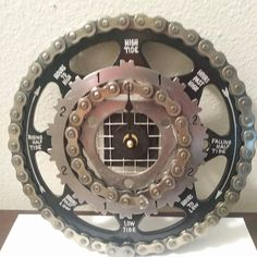 Industrial-steampunk style tide clock made from used motorcycle and automotive parts. SOLD