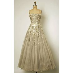 Look what was on display at the Met.  I love this dress... Chambord from House of Dior, circa 1942.