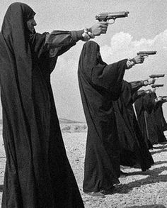Iran. Tehran. Veiled women training shooting in the outskirts of the city.   Photo: Ferdinando Scianna