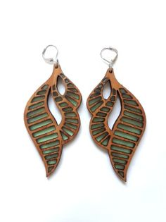 "These earrings are lightweight for their size! They measure 3.25"" long and 1.5"" wide. Designed and hand crafted with carmelized bamboo, custom tinted resin and of course, lots of sandpaper and love. Ear wires are surgical steel."