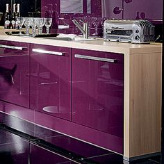 I would most definitely have a purple kitchen if I had a husband who were less fussy about my home decor choices.