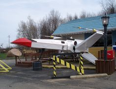Mike's Place, a restaurant in Kent, Ohio, features a homemade X-wing fighter parked right out front. Kent Ohio, My Ohio, Kent State University, X Wing Fighter, College Years, Places To Visit, Park, Architecture, Outdoor Decor
