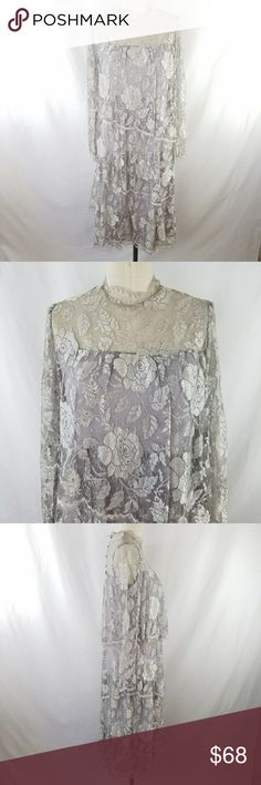 """Vintage Gray Lace Long Sleeve Tiered Dress ✴20% OFF BUNDLES OF 3 OR MORE✴ GORGEOUS!!! More beautiful in person! Shift style with asymetrical lace tiers  Pale gray lace with scattered aurora borealis rhinestones  Sheer sleeves Standing collar with button/loop closure Button cuffs Label size 8 - fits approximately current size 6 34.5"""" Bust 33"""" Waist 38"""" hip  15"""" cross shoulder  Excellent vintage condition!  PLEASE READ CLOSET INFO AND POLICIES POST Vintage Dresses Long Sleeve"""